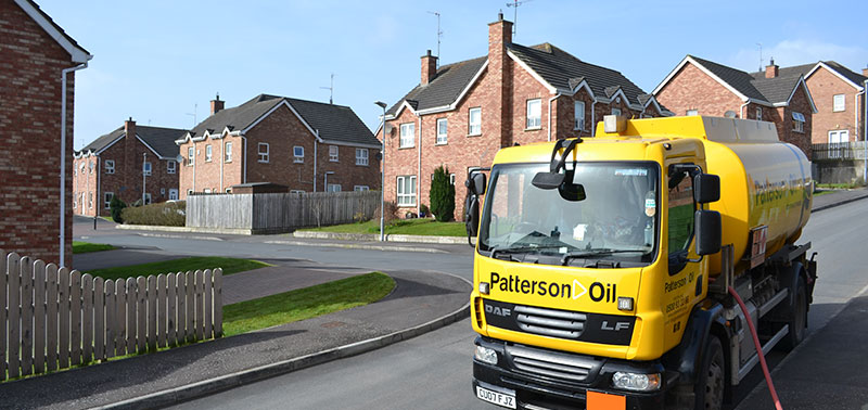 Patterson Oil Tanker delivering oil in a modern housing development