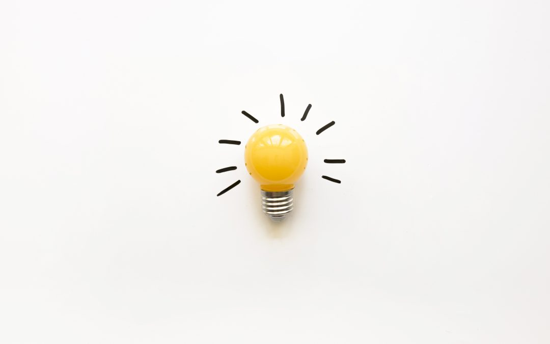 Yellow lightbulb on white background
